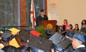 East Limestone senior Elijah Smith speaks during the Ombudsman Center graduation Tuesday at Athens State University. (News Courier/Kim West)