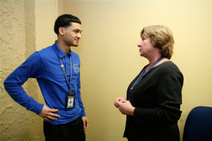 """Luis Lugo (left), who came to Fairhill Community High School after dropping out of a cyber charter, talks with staff psychotherapist Suzette Hunt. """"They come here under stress,"""" she says. (Photo: Harvey Finkle)"""