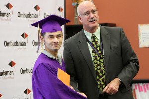 After recieving his high school diploma, Ryan Garcia poses for a photograph with Dr. Robert Winter. Garcia, along with 10 others, graduated from the Ombudsman Center as apart of the Midterm Class of 2014 on Friday afternoon. (Caitlin Dumas/Independent)