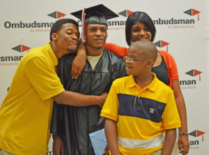 East Limestone senior Shayquon Bradley, 19, center, poses with his brothers Marquez Witchard, left, and Martravus Witchard and sister Marquesha Witchard. Shayquon, who graduated Tuesday through the Ombudsman Center in Athens, plans to enlist in the Marine Corps. (News Courier/Kim West)