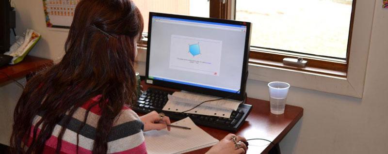 Senior Sydney Kramer goes through one of her lessons at Edtrek.