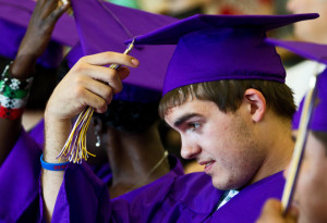 Skylar Zubizareta moves his tassel over along with his fellow graduates during a graduation ceremony Tuesday at the Grand Island Ombudsman Center in Grand Island. Thirteen students were in the graduating class of 2013, many overcoming unique challenges to earn their diploma. (Independent/Matt Dixon)