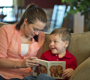 "Jackson ""Jack"" Hines, 5, and Elizabeth Keathley read a story during a therapy session at his home in Easley."
