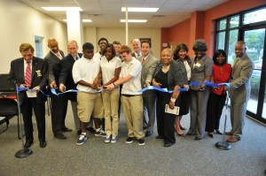 Students, School Board members, Savannah-Chatham Schools representatives, and representatives of Ombudsman Alternative Education Centers cut the ribbon to dedicate the Ombudsman Alternative Education center on Skidaway Road Friday afternoon.