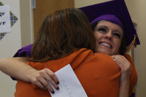Michelle Richardson hugs a family member after her graduation ceremony from the Ombudsman Center on Monday afternoon. (Caitlin Hein/For The Independent)