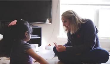 Image of Treva Blackman with student.