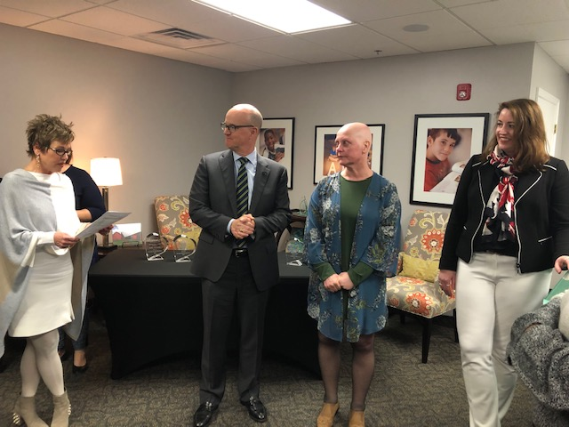 ChanceLight EVP of Special Projects, Gail Davidson, stands in front of gathering at the ChanceLight Nashville office, giving a congratulatory speech to honor the 2018 award recipients.